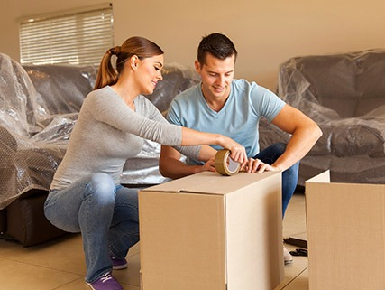 services | couple unpacking in market rate home